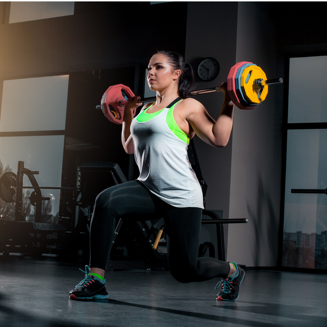 fit-young-woman-lifting-barbells-looking-focused-working-out-gym 1